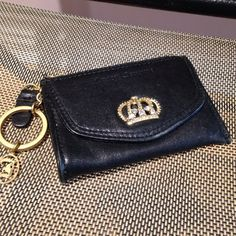 Juicy Couture Leather wallet Authentic , leather outside, cotton inside. Worn gently twice, but has light signs of wear, super cute.  Juicy Couture Bags Wallets