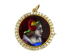 A yellow gold, enamel and diamond round shaped pendant or pin.