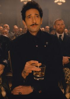 (Willem Dafoe as Jopling and) Adrien Brody as Dimitri in The Grand Budapest Hotel directed by Wes Anderson, 2014 Wes Anderson Style, Wes Anderson Movies, Grand Budapest Hotel, Grande Hotel, Adrien Brody, Ralph Fiennes, Film Stills, Great Movies, Belle Photo
