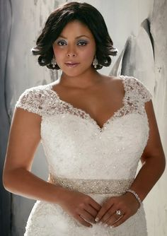 Lace and sparkles look amazing on this plus size #weddingdress - Find more like this at http://www.myweddingconcierge.com.au