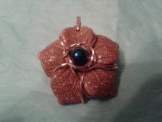 Goldstone flower Wire Wrapped in Copper with a Blue Titanium Bead by MamaGotRocksJewelry on Etsy