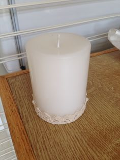Plain pillar candle with crocheted lace! Ahhh, pretty!!