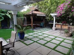 Like the mix of artificial grass and pavers. I think I like the modern, symmetrical look, but it's hard to say with their patio furniture.