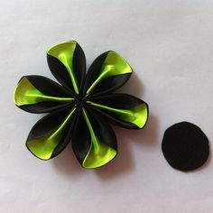 Make flowers to embellishyour hat, dress, shoes, belts, etc..somanypossibilities.  They arealsoideal for scrapbooking, making hair accessories, making cards,or decorating your home or parties.    Materials   ribbon felt gem fabric glue scissors candle / lighter