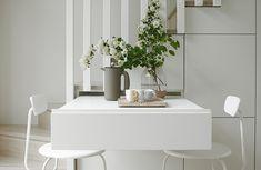 Tilaa säästävää toiminnallisuutta: portaikon alta esiin vedettävä pöytä!