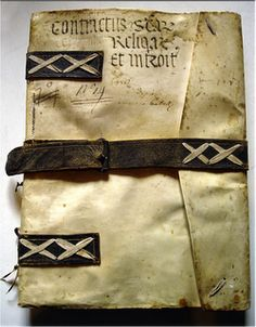italian binding - I like this - I have been saving all of my narrow old belts so that I could use them on books!!