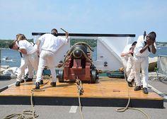Sailors assigned to USS Constitution perform a War of 1812-era gun drill as part of Rockport Navy Weekend festivities.