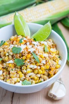 Mexican street corn salad with an amazing blend of sweet corn, salty cheese, sour lime juice and a hint of spicy chili powder; pure summer in a bowl