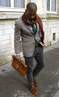 Shop this look on Lookastic:  http://lookastic.com/men/looks/scarf-and-tie-and-dress-shirt-and-blazer-and-belt-and-chinos-and-briefcase-and-desert-boots/1884  — Dark Brown Scarf  — Dark Green Knit Tie  — Light Violet Dress Shirt  — Grey Wool Blazer  — Brown Woven Leather Belt  — Charcoal Chinos  — Brown Leather Briefcase  — Brown Suede Desert Boots