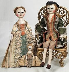 EARLY ENGLISH CARVED WOODEN GENTLEMAN, LADY AND CHILD.