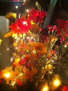 Decorative fake flower arrangement with small lights embedded into the stems and flowers.
