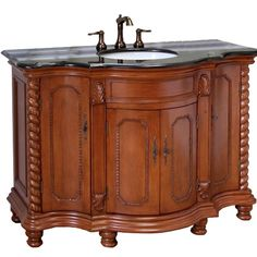 The 48 Inch Wood Rope Single Sink Vanity features a polished stone counter top and light walnut cabinet. #bathroom #bath #storage #bathroomstorage #bathroomideas #cabinet #vanity #GraniteCounterTopsBasementBars