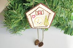 "Mollie at Wild Olive has posted some lovely Christmas ""ornamentation,"" including this darling little cuckoo clock."
