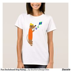 Fun Dachshund Dog Flying a Kite T-Shirt - Fashionable Women's Shirts By Creative Talented Graphic Designers - #shirts #tshirts #fashion #apparel #clothes #clothing #design #designer #fashiondesigner #style #trends #bargain #sale #shopping - Comfy casual and loose fitting long-sleeve heavyweight shirt is stylish and warm addition to anyone's wardrobe - This design is made from 6.0 oz pre-shrunk 100% cotton it wears well on anyone - The garment is double-needle stitched at the bottom and…