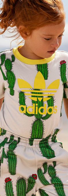 ADIDAS ORIGINALS X MINI RODINI Grey Cactus Print T-Shirt from Sweden. Cute Girls Outfit for Spring Summer. Adorable Casual Outfit for Kid, Tween, Teen Girls. Cool, Comfy & Stylish Outfit Perfect for a Day at the Beach or Streetwear Look. #girlsclothes #girlsclothing #girlsfashion #kidsfashion #fashionkids #childrensclothing