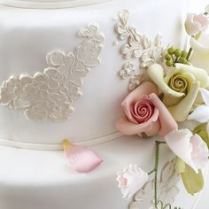 Brides.com: Behind the (Cake) Scenes with Ron Ben-Israel . In addition to the sugar lace applique, the cake seen here is also decorated with sugar roses, sweet peas and berries.    To learn more about Ron Ben-Israel cakes, visit his Web site weddingcakes.com or his Facebook fan page, facebook.com/rbicakes.