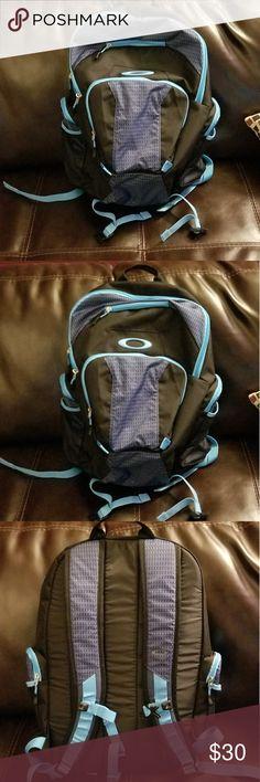OAKLEY Blue and Black bookbag/backpack OAKLEY Blue and Black bookbag/backpack. Super clean. Never really used. Stylish Oakley Bags Backpacks