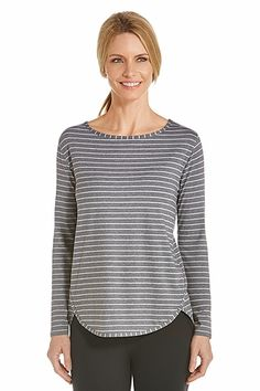 """Turn heads with this relaxed fit sun protective top in rich stripped colors designed for travel or everyday wear. With a """"hits at the hip length"""" this Side Split Shirt is comfortable and sporty right down to the scoop neckline."""