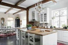 Chandelier over kitchen island Country Living, Kitchen Island, New Homes, Living Room, Storage, Table, Closets, Furniture, Kitchens