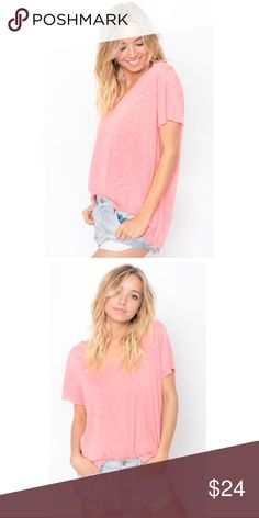 ✨New✨ Boyfriend Tee Sweet & simple tee in a heathered fabric that adds a hint of texture. Light and airy with a relaxed fit; short sleeves, raw edge v-neck and hem. Color is a little brighter than depicted in stock photos (see last photo). More of a light coral- perfect for summer! Tops Tees - Short Sleeve