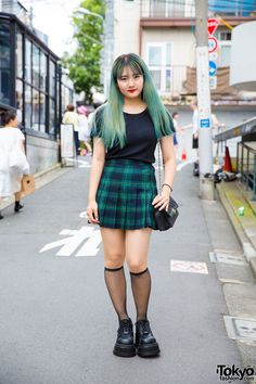19-year-old Aya on the street in Harajuku wearing a plaid skirt from American Apparel with Demonia platforms from Never Mind the XU and a vintage quilted Chanel purse. Full Look