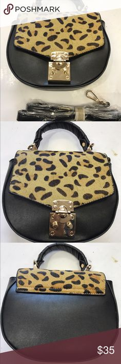 Sr 2 mini satchel w c/b strap Adorable mini satchel light weight with faux animal print flap.  C/b strap fits all sondra roberts Bags Satchels