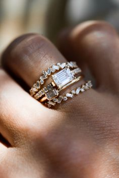 The Gardenia Setting is shown here with an emerald cut diamond, but with the diamond set east-west! It's also shown with the Baguette Cluster.