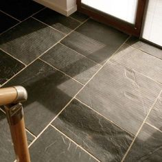 Riven Slate Tiles in a Hall, love the way the sun lights up the texture  - Stoneworks
