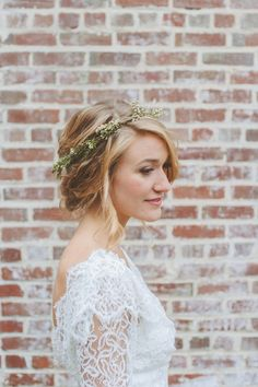 A gorgeous bride rocking a simple green flower crown in her lace white wedding dress. Discover how Vênsette can craft custom beauty looks for your special moment: http://vensette.com/bridal_inquiries