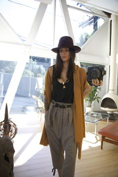 Tasya van Ree Wearing a Gucci hat, tank is Alexander Wang and pants are Yohji Yamamoto