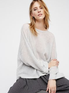 After It Rains Cashmere Pullover   Super luxe and delicate cashmere sweater features a washed ombre effect and is in an effortless oversized fit. This semi-sheer pullover has a rounded neckline and dolman style sleeves.