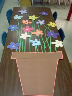 "Going to make the flowers big enough to put a photo of each Sunday School child in the center and put up over the top of flower pot : ""WE ARE GROWING IN GOD'S GRACE!"" :)"