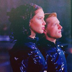 Katniss and Peeta in their fire suits.
