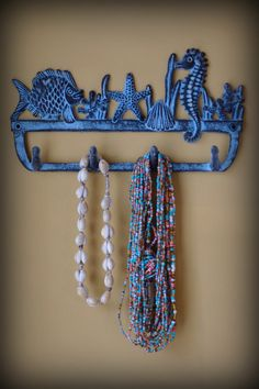 ok... I am LOVING this for towels!! can pick the color too.. to match the curtain! Cast Iron Coral Reef Wall Hook  Fish Coral by ByTheSeashoreDecor, $42.00