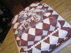 Mississippi State cake - strawberry cake covered in fondant logo cut from fondant