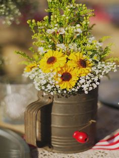 love the country simplistic vibe; sunflower and the like always seem good choice, and sifter is great touch
