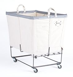 "Boasting a useful mix of tough traits our Steele Canvas 3-Section Laundry Bin is beloved for both its form and function. Originally made in Massachusetts in 1921, durable Steele Canvas baskets and bins quickly became the go-to for the burgeoning New England coal and textile trade. Today they're cherished by hotels and homeowners alike for their combination of steel frame, tough cotton canvas, flat steel undercarriage, and reinforced handles.  * 21-1/2"" W x 28-1/2"" H x 31-1/2"" L * Cotton…"