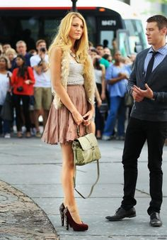 hmm first time i've seen a furry vest look good. so of course it's on blake lively. and those SHOES.