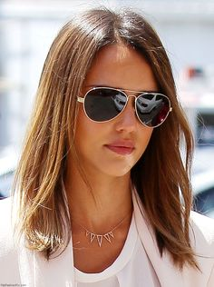 Gorgeous Jessica Alba with Ray Ban sunglasses.