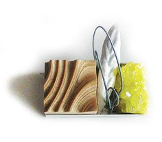 Nevin ArigBrooch: A picture from my garden 2010Chiseled silver, wood, sulfide, iron5x 2,6 x 2,2cm