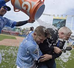 As Kansas City Royals' Salvador Perez delivers the Gatorade shower, Drew Butera holds onto Fox Sports KC broadcaster Joel Goldberg after the teams 6-1 win over the Baltimore Orioles during Sunday's baseball game on April 24, 2016 at Kauffman Stadium in Kansas City, Mo.