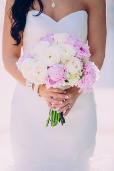 Bouquet featured pink peonies and ivory roses.   Photo by Steadfast Media,   Flowers: Welborn's Floral
