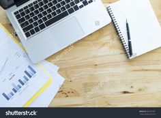 Top View Of Office Wooden Desktop With Analyze Chart, Computer Laptop And Blank White Notebook Stock Photo 365797307 : Shutterstock