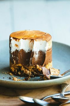 S'mores Custard Cake: This s'mores custard cake approaches the pinnacle of s'mores reinventions. Velvety crème brûlée is layered with crunchy streusel and draped in rich chocolate — all offset by a super light meringue. The tastes and textures mingle like a gourmet party in your mouth