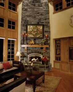 Geyer Victorian Home Family Room Photo 01 from houseplansandmore.com | stone fireplace
