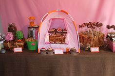 Such a cute girly campout themed party.  I'd vary a few things.  I LOVE the trail mix station and this table with the mini tent!!  Sooo cute!  Also the food table is awesome!