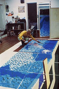 the artist David Hockney drawing on a prepared acetate sheet at Tyler Graphics in 1991