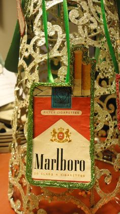 Vintage Marlboro cigarette ad ornament. Because, nothing quite says Christmas like a pack of cigarettes ~