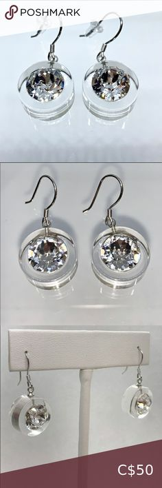Crystal Acrylic Swarovski Dangle Earrings Add some sparkle to your look with these stunning Swarovski® crystal dangle earrings.   Hand made to perfection, set on a transparent lucite, while embellished with a large Swarovski® crystal stone.  These glamorous earrings are lead and nickle free and made with 925 sterling silver backings. Invisible backings included.    Lightweight, easy to wear, comfortable, and look amazing when worn.   Luxury gift box and certificate of authenticity included…