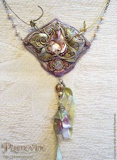 This has been an alchemical piece for me, it's reached my dreams, my current life events, my wishes and aspirations, and my appreciation for the beauty and raw energy of nature and the Goddess.  The seed of a new phase in my life..  It took a number of days to finish as I had to stop after so much time putting her together, and in between these breaks new discoveries would arrive, especially the coloured leather cords. I knew something was missing, something that I didn't have with me but I…